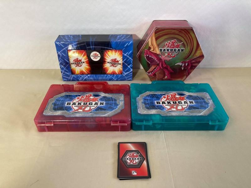 Lot van 4 speldozen met Bakugan kaarten en Battle Brawlers