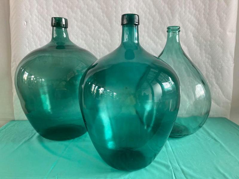 3 grote groene demijohn flessen