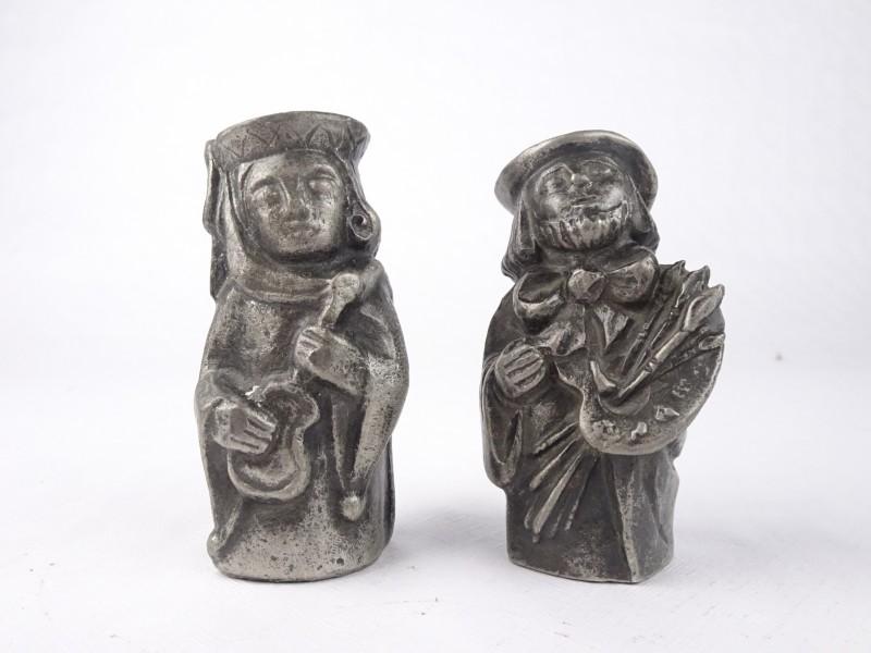 2 kleine metalen kunstwerkjes gemerkt Arlette Laurent Dray.