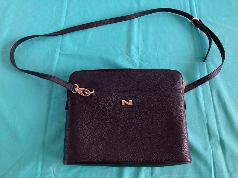 Zwarte luxe handtas gelabeld Nathan - Baume