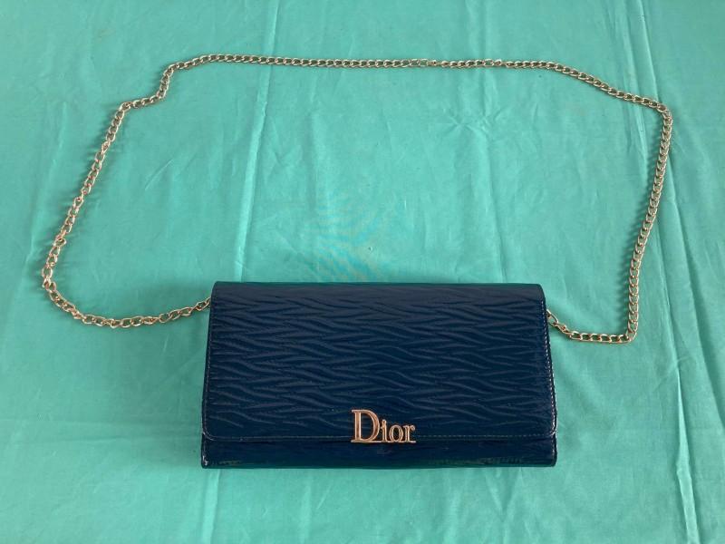 """Blauwe handtas gelabeld """"Dior"""""""
