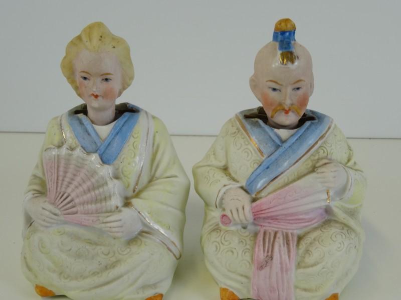 Chinees koppel met knikkende hoofden