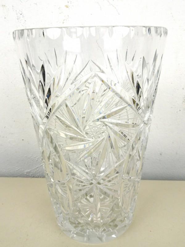 Glazen stolp met wassen beeld