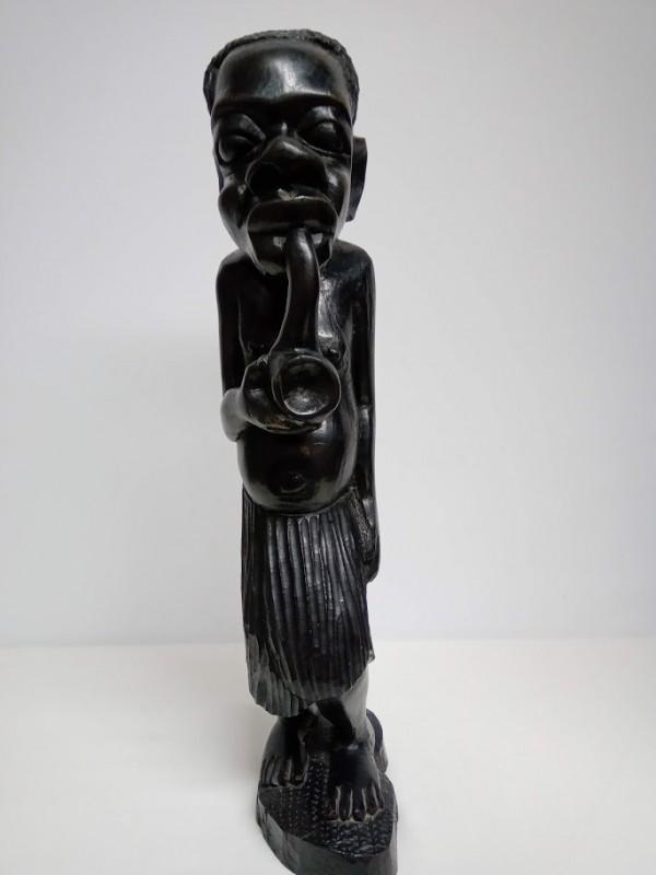 Beeld van  Afrikaanse man met pijp